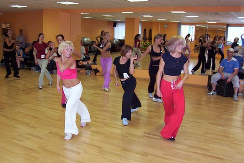 aerobic dance Definition group choreography of 8 competitors, utilizing the aerobic  movements in dance style the routine must include 32 to 64 counts of street .